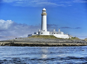 Lighthouse on West Coast of Scotland at the end of summer