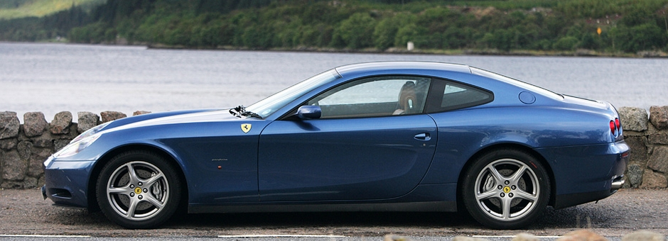 Car Club Blue Ferrari in front of Loch on West Coast of Scotland
